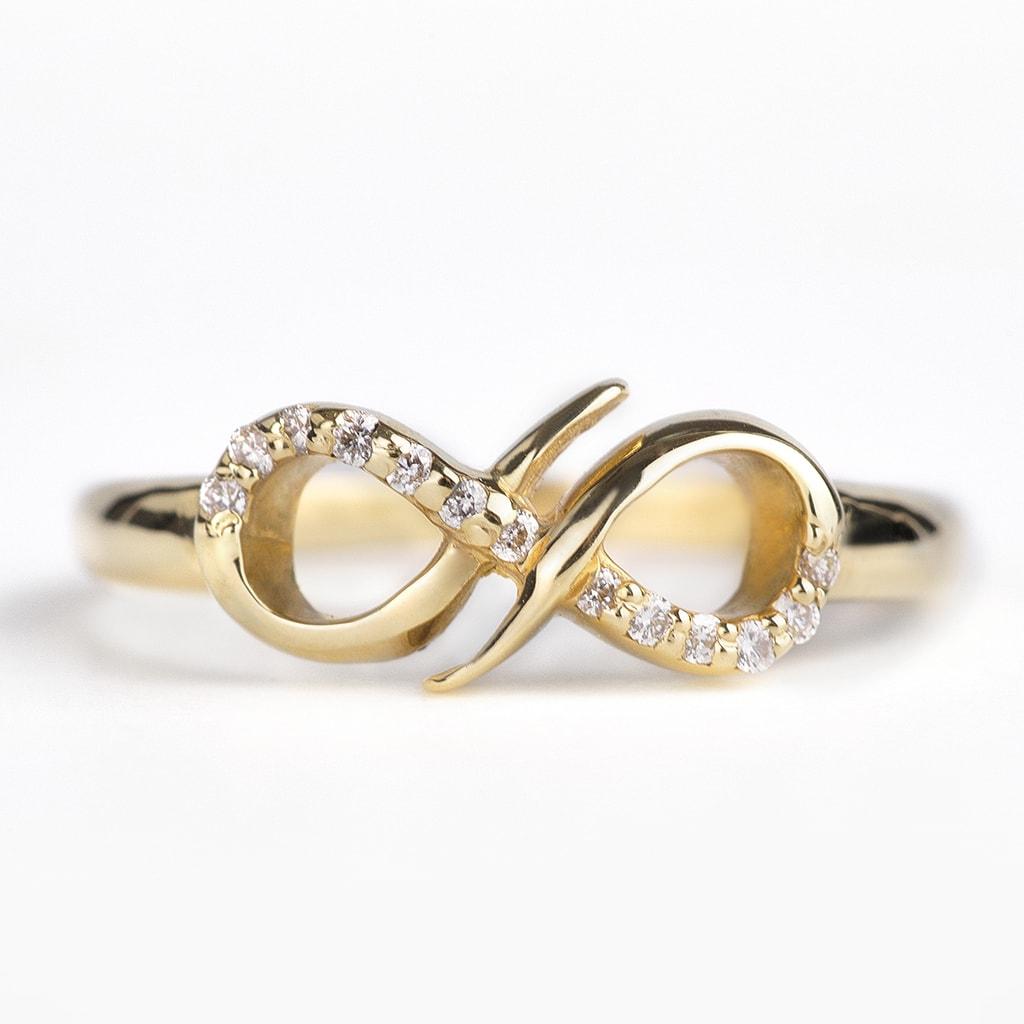 bague en or avec diamants signe de l 39 infini klenota. Black Bedroom Furniture Sets. Home Design Ideas