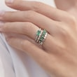 Emerald ring with two diamonds