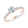 Aquamarine and diamond band engagement ring in rose gold