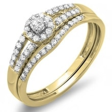 A DIAMOND ENGAGEMENT AND WEDDING RING - GOLD RINGS - RINGS