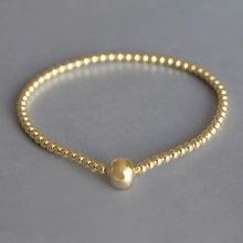 Gold-plated bracelet with ball - Jewellery Sale