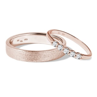 Wedding rings of rose gold with diamonds