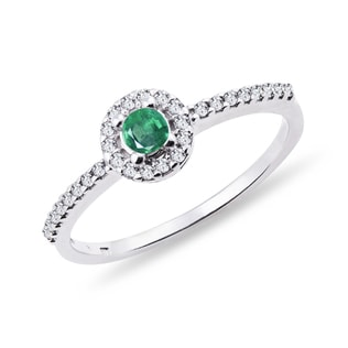 Diamond ring with emerald