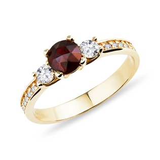 Gold ring with diamonds and garnets