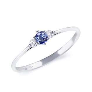 Gold engagement ring with sapphire