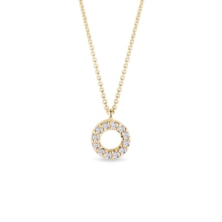 Circular diamond charm in yellow gold