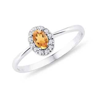 Citrine and diamond halo ring in white gold