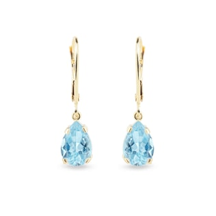 Gold earrings with blue topaz