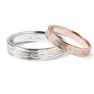 Wedding rings of rose and white gold