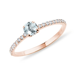 Aquamarine ring with a diamond band in rose gold