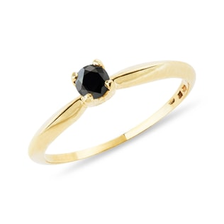 Gold ring with black diamond