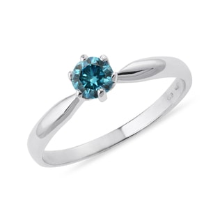 Engagement ring with blue diamond