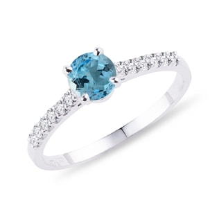 Topaz and diamond band engagement ring in white gold