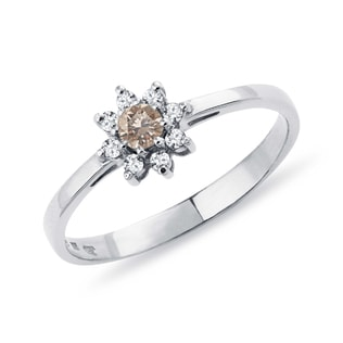 White gold ring in the shape of a flower
