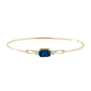 GOLD BRACELET WITH A SAPPHIRE AND DIAMONDS - WOMEN'S BRACELETS - FINE JEWELRY