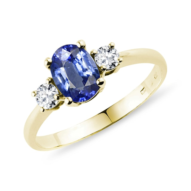 Gold ring with a sapphire and diamonds