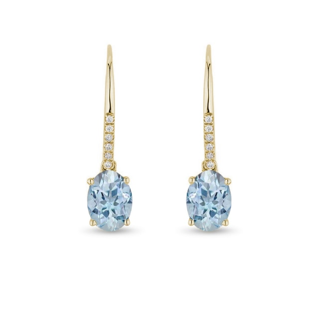 Earrings made of yellow gold with topaz and diamonds