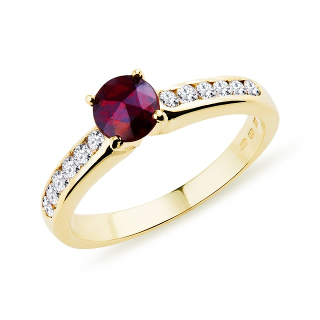Gold ring with garnet and diamonds