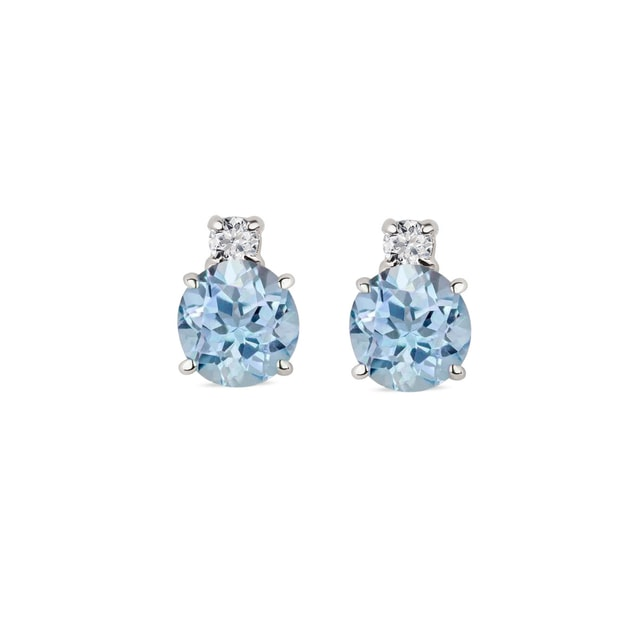 Diamond and blue topaz earrings in 14kt white gold