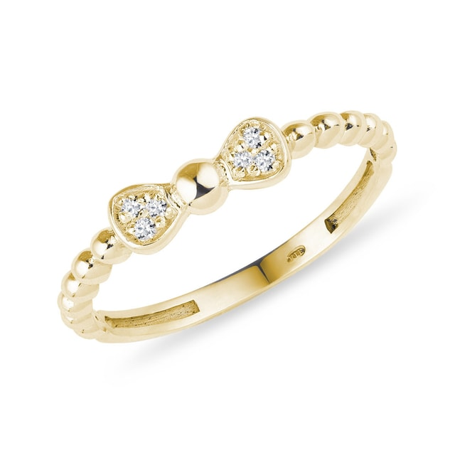 Diamond bow ring in yellow gold