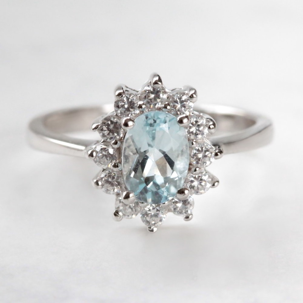 klenota silver ring with aquamarine and cz halo