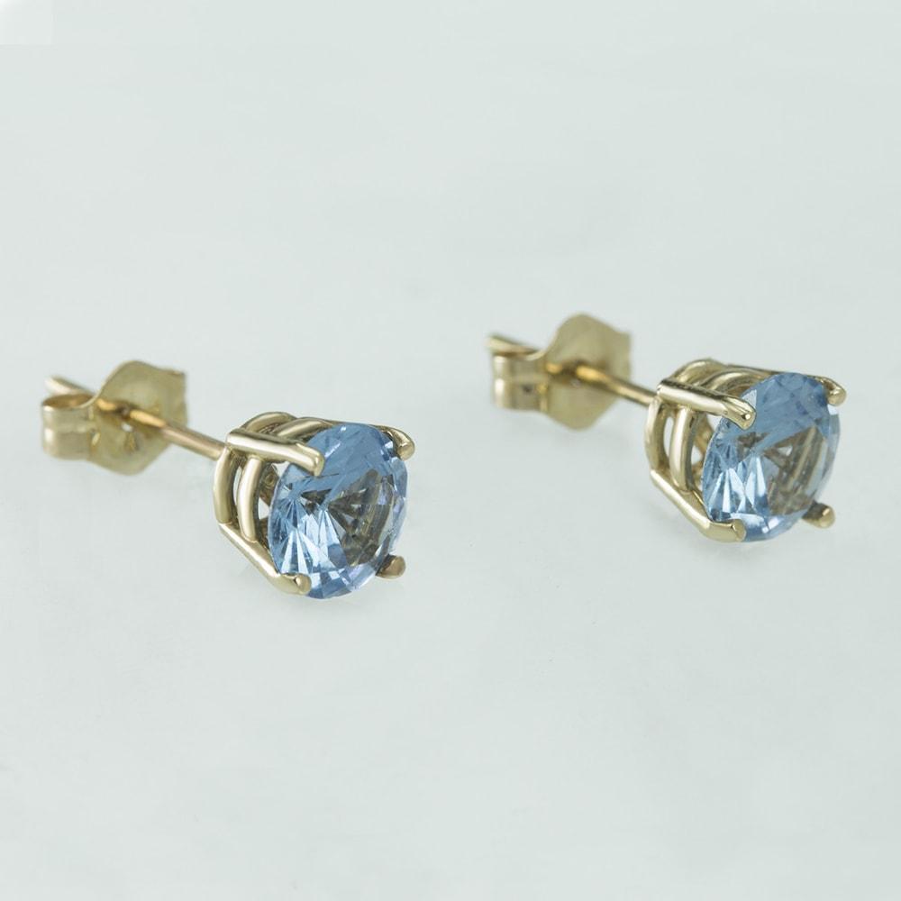 klenota boucles d 39 oreilles avec topaze bleue boucles d. Black Bedroom Furniture Sets. Home Design Ideas
